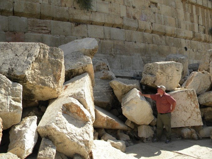 The author among large hewn stones thrown down during the destruction of the Temple in 70 C.E.
